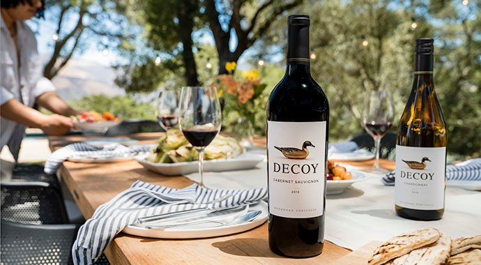 Decoy on a table with food and wine glasses