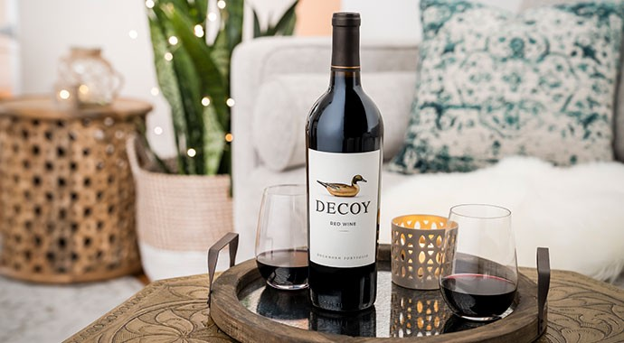 Decoy rose wine on outdoor table next to pool