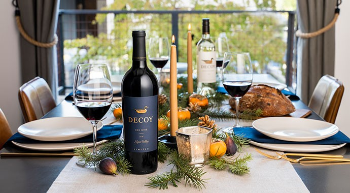 Decoy Limited Red Wine and Decoy Sauvignon Blanc on a holiday decorated table