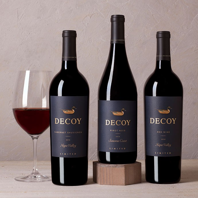 Three bottles of Decoy Limited with a glass of wine