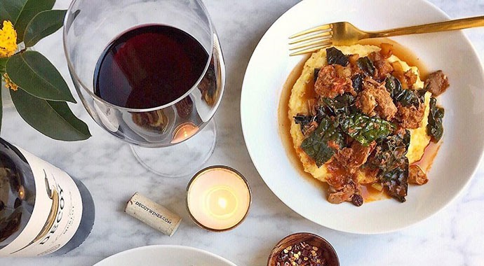 Decoy Merlot and wine on countertop with polenta